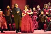 Tenor Garrett Sorenson as Alfredo and soprano Dina Kuznetsova as Violetta with the cast of La traviata, La Traviata, Boston Lyric Opera, 2006