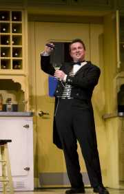 Pedrillo (Tim Oliver, tenor) pours a sleep serum as part of the escape plan, The Abduction from the Seraglio, 2008