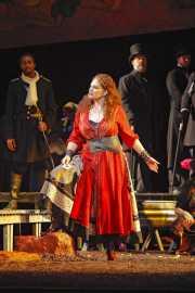 Carmen (mezzo-soprano Dana Beth Miller) warns men to watch out if she falls in love with them, Carmen, Boston Lyric Opera, 2009