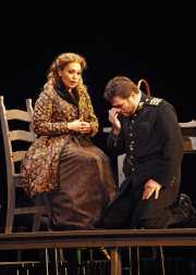 Don José (tenor John Bellemer) is overcome with emotion while hearing a message from his mother conveyed by the devout Micaëla (soprano Hanan Alattar)., Carmen, Boston Lyric Opera, 2009