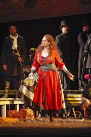 Carmen (mezzo-soprano Dana Beth Miller) warns men to watch out if she falls in love with them, Carmen, Boston Lyric Opera, 2009