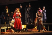 Carmen (mezzo-soprano Dana Beth Miller) contemplates new love as fellow gypsy Mercédès (mezzo-soprano Stephanie Chigas), Spanish soldiers, and cigarette girls look on., Carmen, Boston Lyric Opera, 2009