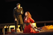 Carmen (mezzo-soprano Dana Beth Miller) swears she will love Don José (tenor John Bellemer) if he releases her from prison., Carmen, Boston Lyric Opera, 2009