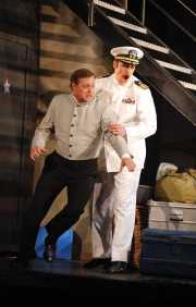 The Officer (tenor Neal Ferreira) refuses to let the Lackey (bass John Whittlesey) stop him from seeing the beautiful Zerbinetta in her dressing room., Ariadne auf Naxos, Boston Lyric Opera, 2010