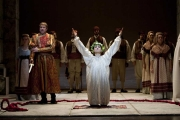 The Greek prince Idamante (mezzo-soprano Sandra Piques Eddy) offers himself to be sacrificed by his father, Idomeneo (tenor Jason Collins), to pay off the king's debt to Neptune and save the people of Crete, Idomeneo re di Creta, Boston Lyric Opera, 2010