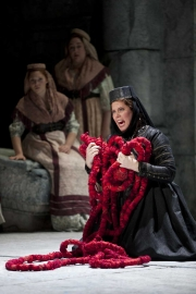 The notorious Greek princess Elettra (soprano Caroline Worra) begins to lose her mind as her final dreams of happiness unravel, Idomeneo re di Creta, Boston Lyric Opera, 2010
