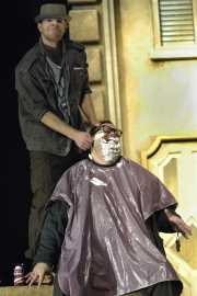 The barber of Seville, Figaro (baritone Gregory Gerbrandt), distracts his patron, Doctor Bartolo (bass-baritone T. Steven Smith) with a shave, Boston Lyric Opera, 2010