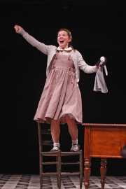 Flora (soprano Kathryn Skemp) seeks attention during a Latin lesson, The Turn of the Screw, 2010