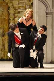 Agrippina (Soprano Caroline Worra) punishes Pallante (Baritone David McFerrin) and Narciso (Countertenor José Álvarez) for their efforts to thwart her campaign to make her son Emperor. Photo taken at final dress rehearsal of BLO's Agrippina by Jeffrey Dunn for Boston Lyric Opera © 2011