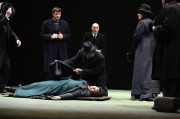 Grieving husband Tichon (Alan Schneider) prepares to cover Kátya's lifeless body (Elaine Alvarez) in Boston Lyric Opera's production of Kátya Kabanová, composed by Leoš Janáček. 2015