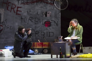 "(l.-r.) Rodolfo (Jesus Garcia) playfully captures film footage of Mimi (Kelly Kaduce) soon after the pair meet in 1960s Paris, in Boston Lyric Opera's new production of ""La Bohème,"" directed by Rosetta Cucchi in her U.S. debut and running Oct 2-11 at the Citi Performing Arts Center Shubert Theatre in Boston"
