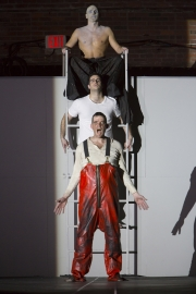 """(From top): Yury Yanowsky as the Man, Neal Ferreira as The Visitor, and David McFerrin as The Officer in Boston Lyric Opera's new """"Opera Annex"""" production of Philip Glass's dystopian """"In the Penal Colony"""" based on the Franz Kafka short story, and in a limited run Nov 11-15 at the historic Cyclorama at the Boston Center for the Arts."""