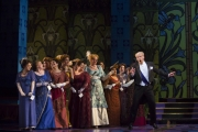 Roger Honeywell, as Count Danilo, surrounded by the ensemble in Boston Lyric Opera's new production of The Merry Widow running April 29-May 8 at the Citi Shubert Theater.