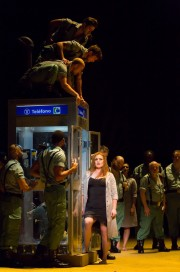 """Carmen (Jennifer Johnson Cano) gets some bad news after her shift at the cigarette factory while being surrounded and ogled by soldiers in Boston Lyric Opera's production of Georges Bizet's """"Carmen"""" directed by Calixto Bieito. """"Carmen"""" opens BLO's 40th Season, at the Boston Opera House through October 2."""