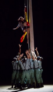 """A town woman is hoisted up a flagpole by a group of unruly soldiers in Boston Lyric Opera's production of Georges Bizet's """"Carmen"""" directed by Calixto Bieito. """"Carmen"""" opens BLO's 40th Season, at the Boston Opera House through October 2."""