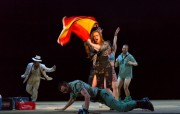 """Carmen (Jennifer Johnson Cano) leads a boisterous drunken party in which her gypsy friends mingle and play bullfighter with local soldiers in Boston Lyric Opera's production of Georges Bizet's """"Carmen"""" directed by Calixto Bieito. """"Carmen"""" opens BLO's 40th Season, at the Boston Opera House through October 2."""