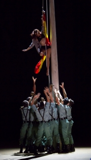 "A town woman is hoisted up a flagpole by a group of unruly soldiers in Boston Lyric Opera's production of Georges Bizet's ""Carmen"" directed by Calixto Bieito. ""Carmen"" opens BLO's 40th Season, at the Boston Opera House through October 2."
