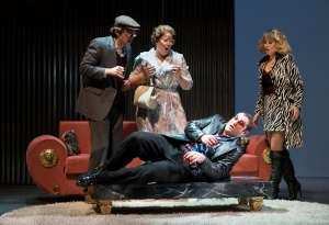 Playing out his apparent Oedipal fate, Eddy (Marcus Farnsworth, on table) reacts to disturbing news by attempting to gouge his own eyes as his parents (Christopher Burchett and Caroline Worra) and his wife (Amanda Crider) look on in horror, in the Boston Lyric Opera production of Mark Anthony Turnage's GREEK, running Nov 16-20 at the Emerson/Paramount Center.