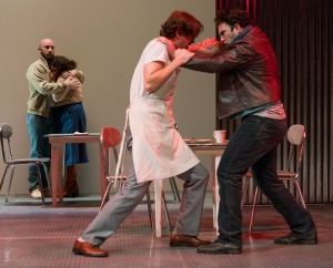 "Marcus Farnsworth (r.) as ""Eddy"" battles with the diner owner (Christopher Burchett) in the Boston Lyric Opera production of Mark Anthony Turnage's GREEK, running Nov 16-20 at the Emerson/Paramount Center."