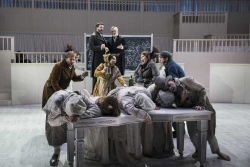 FRESHER BETTER -- As the disturbingly fresh corpses pile up in 1828 Scotland (foreground), Burke, Hare and their companions (center) celebrate newfound wealth, while anatomy school purveyors Dr. Ferguson (David McFerrin, rear left) and Dr. Knox (William Burden, rear right) face a bright future in Boston Lyric Opera's world premiere production of THE NEFARIOUS, IMMORAL BUT HIGHLY PROFITABLE ENTERPRISE of MR. BURKE and MR. HARE by composer Julian Grant and librettist Mark Campbell. Runs Nov 8-12; details at BLO.org.