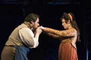 Artist Cavaradossi (Jonathan Burton) kisses the hand of singer Floria Tosca (Elena Stikhina) in the Boston Lyric Opera production of TOSCA, running Oct 13-22 at the Cutler Emerson Majestic Theater. Tickets BLO.org.