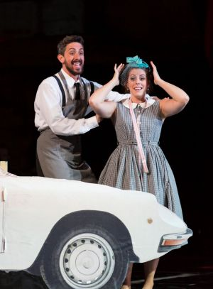 """In the Count's garage where he keeps the cars in tip-top shape, Figaro (Evan Hughes, r.) helps Susanna (Emily Birsan) imagine their upcoming nuptials in Boston Lyric Opera's new production of """"The Marriage of Figaro"""" running through May 7 at John Hancock Hall"""