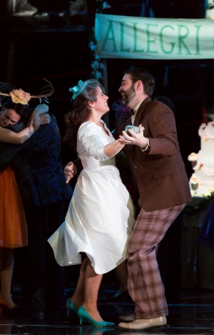 "Susanna (Emily Birsan, l.) accepts a dance from her newly discovered father-in-law Basilio (Matthew DiBattista) at her wedding reception in Boston Lyric Opera's new production of ""The Marriage of Figaro"" running through May 7 at John Hancock Hall"