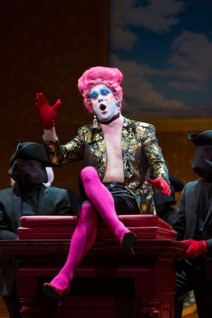 Sellem the auctioneer (Jon Jurgens) takes glee in the sale of Rakewell's worldly possessions in Boston Lyric Opera's new production of Stravinsky's THE RAKES PROGRESS, running through March 19 at the Emerson Majestic Theater