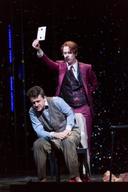 Nick Shadow (Kevin Burdette) forces Tom Rakewell (Ben Bliss) into a life or death card game in Boston Lyric Opera's new production of Stravinsky's THE RAKES PROGRESS, running through March 19 at the Emerson Majestic Theater