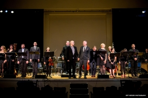 Composer Julian Grant and librettist Mark Campbell take a bow, center, with the company of the OPERA America New Works Showcase of The Nefarious, Immoral but Highly Profitable Enterprise of Mr. Burke & Mr. Hare, conductor Erik Ochsner and the SONOS Chamber Orchestra.