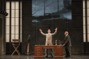 Irving Thalberg (Jesse Darden, c.) proclaims to Arnold Schoenberg (Omar Ebrahim, l.) his confidence in the new artform of film in Boston Lyric Opera's World Premiere SCHOENBERG IN HOLLYWOOD by composer Tod Machover and librettist Simon Robson.