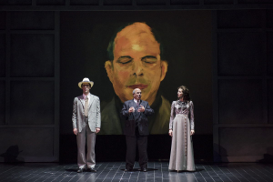 Framed by a self-portrait painting, Arnold Schoenberg (Omar Ebrahim, c.) recalls a romantic moment from his past, reenacted by Jesse Darden (l.) and Sarah Womble (r.) in Boston Lyric Opera's World Premiere SCHOENBERG IN HOLLYWOOD by composer Tod Machover and librettist Simon Robson.