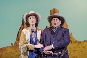 In the style of a cowboy western film, Arnold Schoenberg (Omar Ebrahim, r.) and his second wife Gertrud Kolisch (Sarah Womble, l.) trek across the country to their ultimate destination of Los Angeles in Boston Lyric Opera's World Premiere SCHOENBERG IN HOLLYWOOD by composer Tod Machover and librettist Simon Robson.