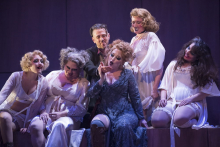 Jenny (Renee Tatum, in blue) reads the palm of Macheath (Christopher Burchett, center, top) in the Boston Lyric Opera's production of Weill and Brecht's THE THREEPENNY OPERA, running March 16-25 at the Huntington Avenue Theatre.  BLO.org.