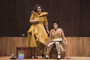 Lucy (Chelsea Basler, l.) silences Polly Peachum (Kelly Kaduce), her rival for Macheath's affections with a piece of cake in the Boston Lyric Opera's production of Weill and Brecht's THE THREEPENNY OPERA, running March 16-25 at the Huntington Avenue Theatre.  BLO.org.