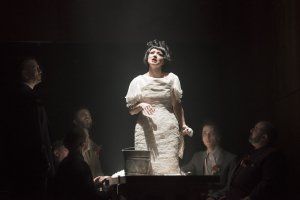 """Kelly Kaduce as Polly Peachum sings the iconic """"Pirate Jenny"""" in the Boston Lyric Opera's production of Weill and Brecht's THE THREEPENNY OPERA, running March 16-25 at the Huntington Avenue Theatre.  BLO.org."""