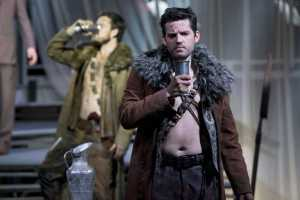 """Junius (David McFerrin) and his soldier comrades spend an evening on the battlefield drinking wine and absorbing news of their wives' infidelity back home in Boston Lyric Opera's production of """"The Rape of Lucretia"""" March 11-17 at Artists for Humanity EpiCenter."""
