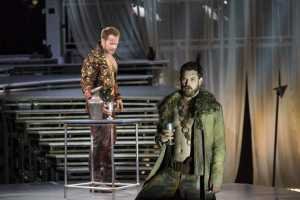 """Facing harassment from Tarqunius (Duncan Rock, rear) about his faithful wife, Collatinus (Brandon Cedel, fore) sings of love, war and fidelity in Boston Lyric Opera's production of """"The Rape of Lucretia"""" March 11-17 at Artists for Humanity EpiCenter."""