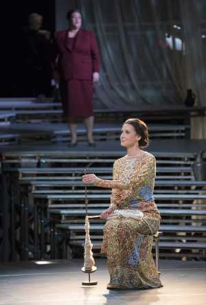 """Lucretia (Kelley O'Connor) spins wool while thinking of her husband Collatinus, who is away at war against the Estrucans in Boston Lyric Opera's production of """"The Rape of Lucretia"""" March 11-17 at Artists for Humanity EpiCenter."""