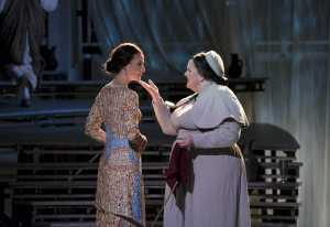 """Nurse Bianca (Margaret Lattimore, r.) consoles Lucretia (Kelley O'Connor) who pines for her husband Collatinus in Boston Lyric Opera's production of """"The Rape of Lucretia"""" March 11-17 at Artists for Humanity EpiCenter"""