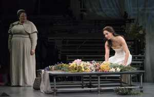 """The morning after Tarquinius has violated her, Lucretia (Kelley O'Connor, kneeling) comes into the garden dazed, angry and confused and her nurse Bianca (Margaret Lattimore, l.) struggles to understand what has happened in Boston Lyric Opera's production of """"The Rape of Lucretia"""" March 11-17 at Artists for Humanity EpiCenter."""