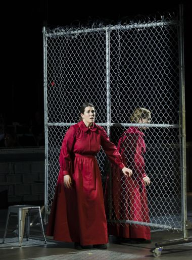 "Moira (Chelsea Basler) tells Offred (Jennifer Johnson Cano) about her plans to escape the Handmaid life in Boston Lyric Opera's production of ""The Handmaid's Tale,"" running through May 12"