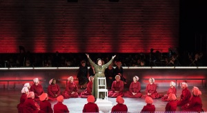 "Aunt Lydia (Caroline Worra) leads the handmaids through their prayers in Boston Lyric Opera's production of ""The Handmaid's Tale,"" running through May 12. BLO.org."