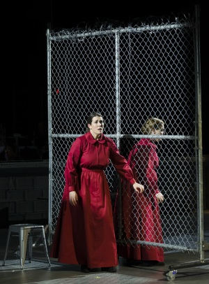 """Moira (Chelsea Basler) tells Offred (Jennifer Johnson Cano) about her plans to escape the Handmaid life in Boston Lyric Opera's production of """"The Handmaid's Tale,"""" running through May 12. BLO.org."""