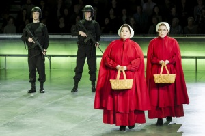 """Ofglen (Michell Trainor) and Offed (Jennifer Johnson Cano) try not to seem suspicious on their daily walk in Boston Lyric Opera's production of """"The Handmaid's Tale,"""" running through May 12. BLO.org."""
