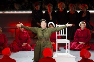 """Aunt Lydia (Caroline prepares the handmaidens for a birthing ritual in Boston Lyric Opera's production of """"The Handmaid's Tale,"""" running through May 12. BLO.org."""
