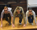 Teachers create a tableau of Three Blind Mice during the summer Professional Development Intensive.