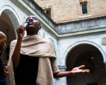 Spoken word artist, Adobuere Ebiama performs during Crossing the Line to Freedom: A Musical Narrative in the Boston Public Library's courtyard.