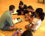 Teacher participants in Opera Creation Boot Camp help youth create a story from their chosen image.