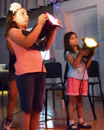 Opera Camp youth learn about lighting design.